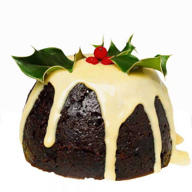 christmas pudding with custard --- Image by © Royalty-Free/Corbis