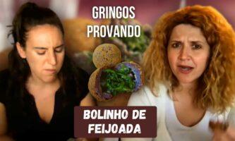 Gringos provando bolinho de feijoada